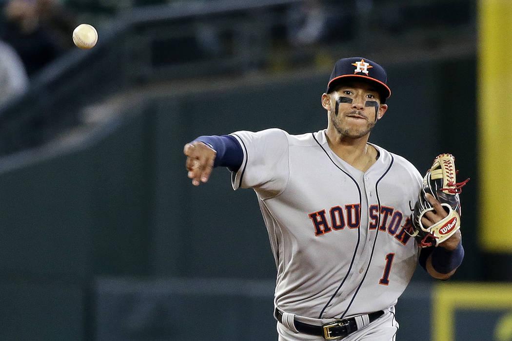 El torpedero de los Astros de Houston, Carlos Correa. | AP Foto/Elaine Thompson