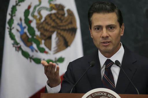 El presidente de Mexico Enrique Peña Nieto (foto de archivo del 4 de enero del 2017) declaró en la ciudad de México, el 11 de enero del 2017, que su país no pagará ningún muro fronterizo. (A ...