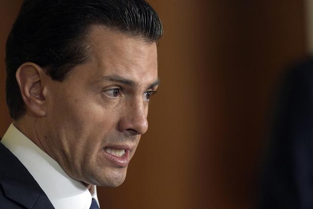 En esta foto de archivo tomada el 22 de julio de 2016, el presidente de México, Enrique Peña Nieto, habla durante una conferencia de prensa con el presidente Barack Obama en el Salón Este de la ...
