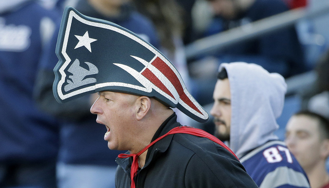 A New England Patriots fan cheers during the second half of an NFL football game between the Patriots and the Washington Redskins, Sunday, Nov. 8, 2015, in Foxborough, Mass. (AP Photo/Steven Senne)