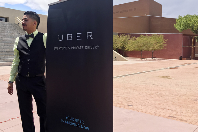 Isaac Sanchez, 28, a driver for ride-hailing company Uber, prepares to speak at a press conference Monday, Aug. 22, 2016, at the National Hispanic Cultural Center in Albuquerque, N.M., about Uber' ...