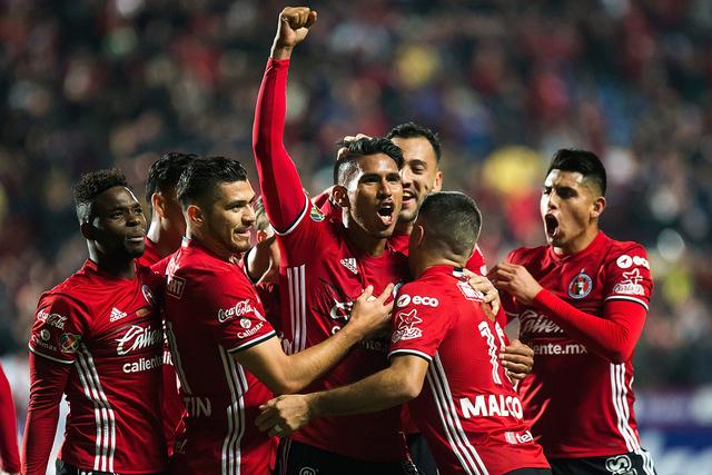 Jugadores de Tijuana festejan el gol del triunfo anotado por Juan Carlos Valenzuela, el viernes 27 de enero en el estadio Caliente de Tijuana, México. Foto Cortesía Club Tijuana.