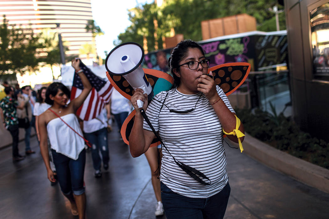 Several hundred Deferred Action for Childhood Arrival program (DACA) recipients and supporters march down the Strip in Las Vegas, Sunday, Sept. 10, 2017, to call on President Donald Trump and Neva ...