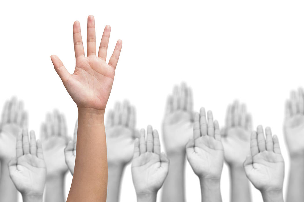 business crowd raising hands, many hands raise high up on white background