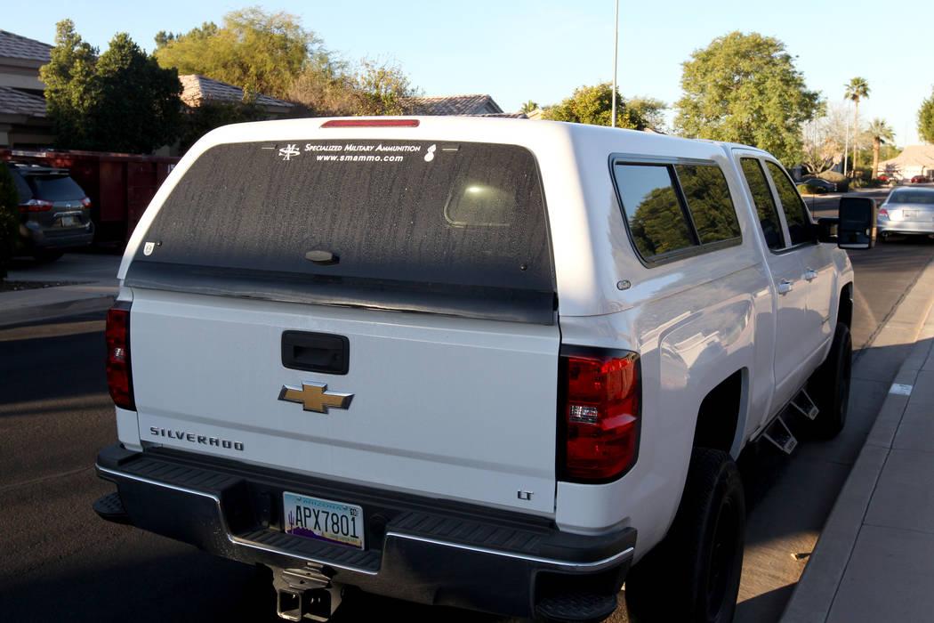 Un vehículo frente a la casa de Douglas Haig en Mesa, Arizona, el miércoles, 31 de enero de 2018. El negocio de Haig, munición militar especializada, se anuncia en la parte posterior. K.M. Cann ...
