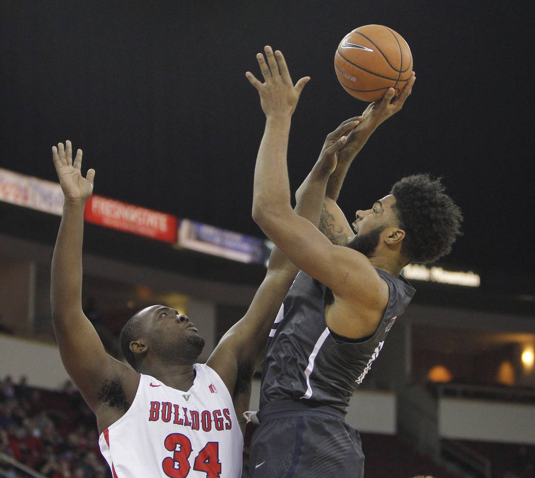 Nevada's Elijah Foster goes up for a shot against Fresno State's Terrell Carter II during the first half of an NCAA college basketball game in Fresno, Calif., Wednesday, Dec. 27, 2017. (AP Photo/G ...
