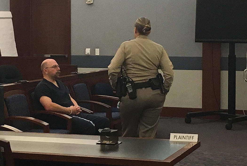 Las Vegas police officer Bret Theil, left, awaits an arraignment on dozens of sexual assault and kidnapping charges on Wednesday, Feb. 14, 2018. (David Ferrara/Las Vegas Review-Journal)