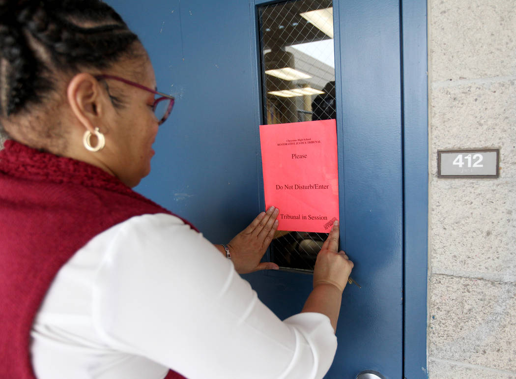 Regina James, a school counselor at Cheyenne High School in North Las Vegas, places a sign outside school's student-run restorative justice tribunal Wednesday, Feb. 21, 2018. K.M. Cannon Las Vegas ...