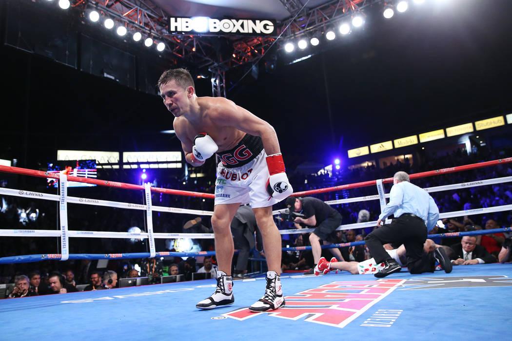 Gennady Golovkin, izquierda, celebra su victoria por nocaut contra Vanes Martirosyan en la segunda ronda de la pelea de campeonato de peso mediano WBC y AMB en el StubHub Center en Carson, Califor ...