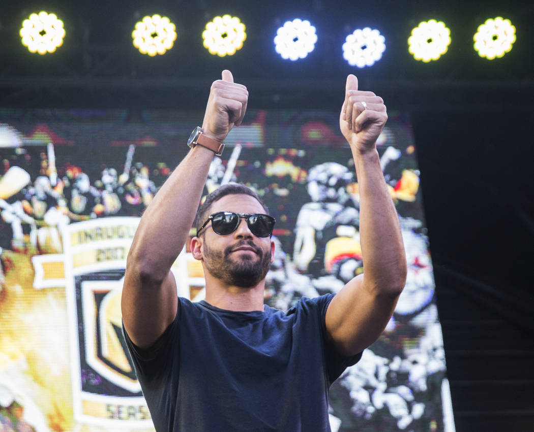 """Golden Knights right wing Pierre-Edouard Bellemare salutes fans during """"Stick Salute to Vegas and Our Fans"""" on Wednesday, June 13, 2018, at the Fremont Street Experience, in Las Vega ..."""