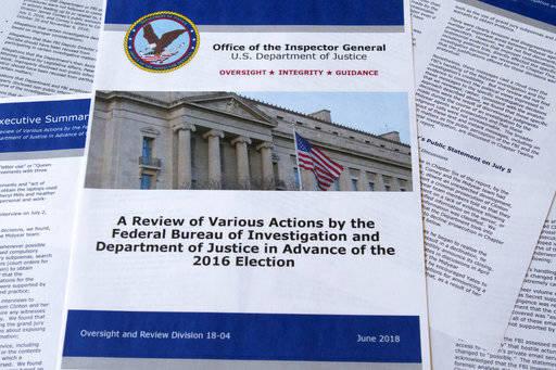 Parte del informe del Inspector General del Departamento de Justicia después de su lanzamiento en Washington, el jueves 14 de junio de 2018. El informe documentó minuciosamente una de las invest ...