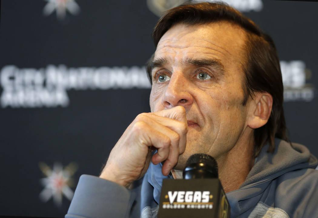 El gerente general de Vegas Golden Knights, George McPhee, escucha la pregunta de un periodista durante una conferencia de prensa en Las Vegas, el domingo 1 de julio de 2018, para discutir la aper ...