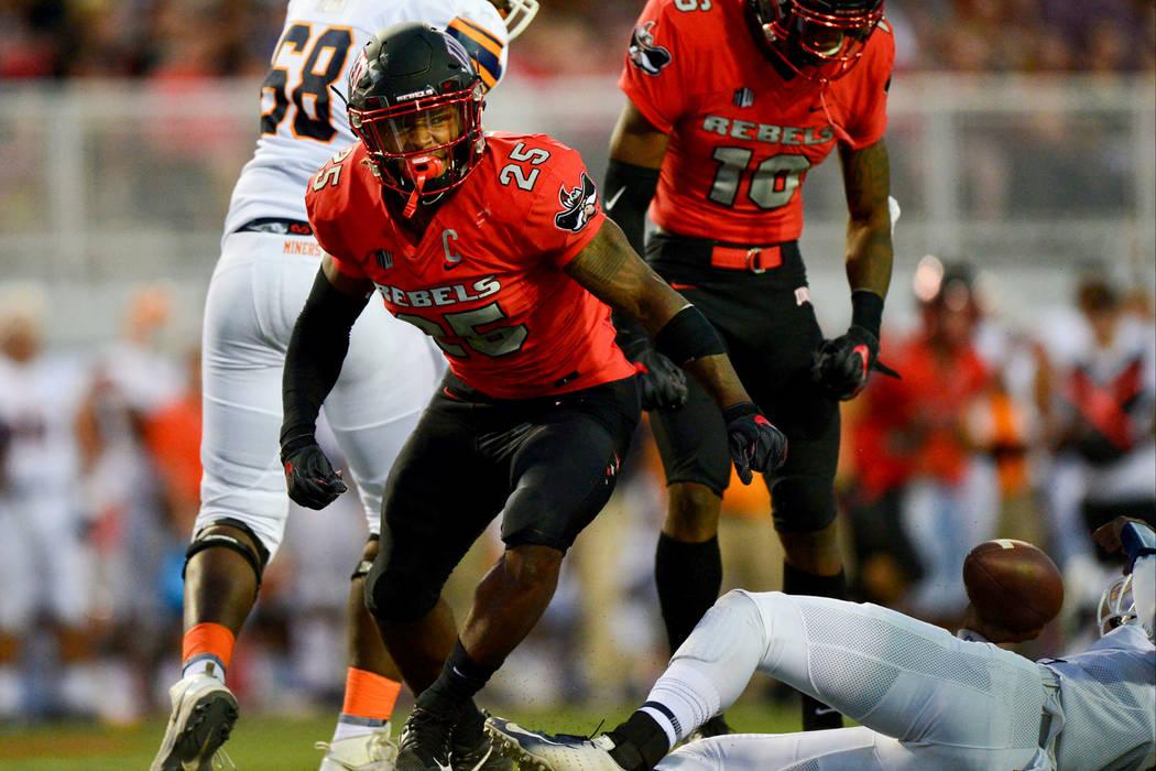 UNLV Rebels linebacker Gabe McCoy (25) breaks through the UTEP Miners offensive line at Sam Boyd Stadium in Las Vegas on Saturday, Sept. 8, 2018. UNLV leads at halftime 38-10. Brett Le Blanc Las V ...