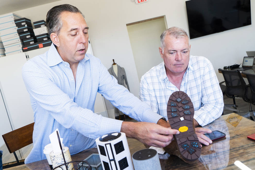 Los cofundadores de Ross & Snow: Fred Mossler, izquierda, y Steve Hill hablan sobre su producto en una entrevista en la sede de la compañía de calzado en el centro de Las Vegas, el lunes 10 de s ...