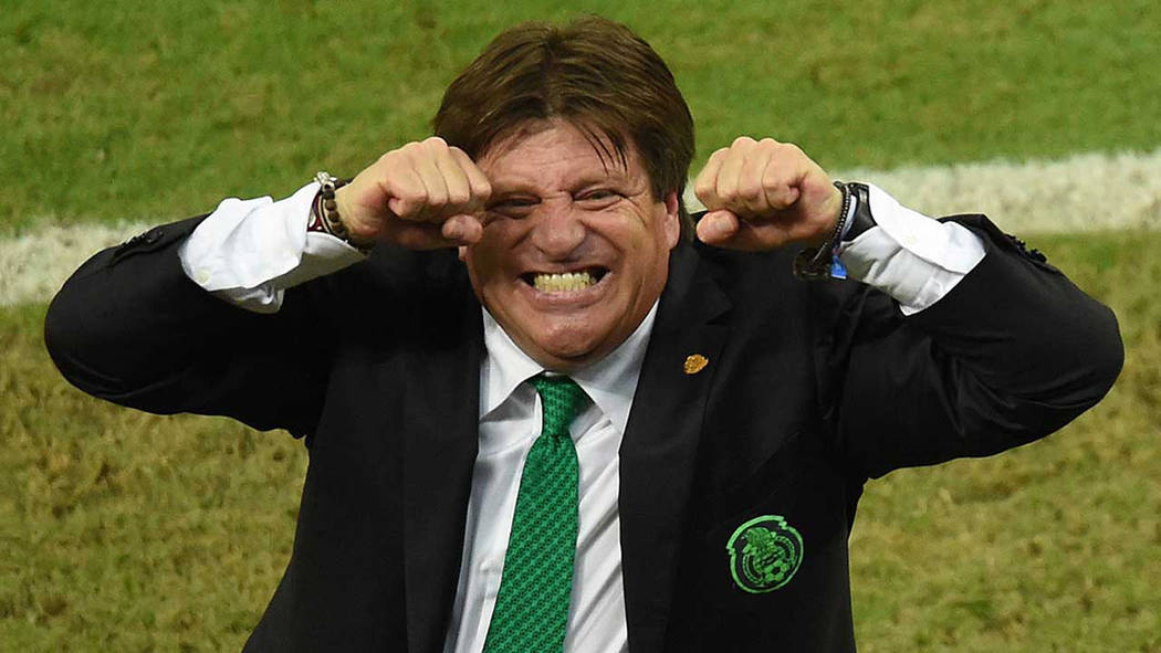 Mexico's coach Miguel Herrera celebrates after his team won a Group A football match between Croatia and Mexico at the Pernambuco Arena in Recife during the 2014 FIFA World Cup on June 23, 2014. M ...