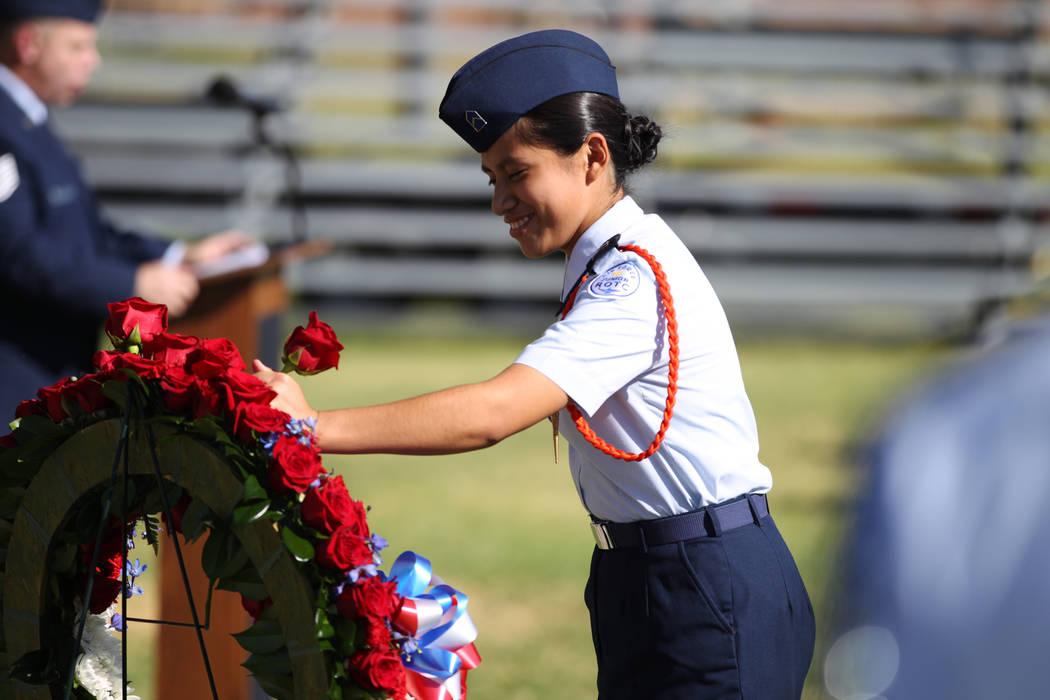 Mayela López, miembro de JROTC de Rancho High School, coloca una flor en una corona durante la ceremonia del Día de Reconocimiento de prisioneros de guerra/MIA en el Freedom Park dentro de la Ba ...