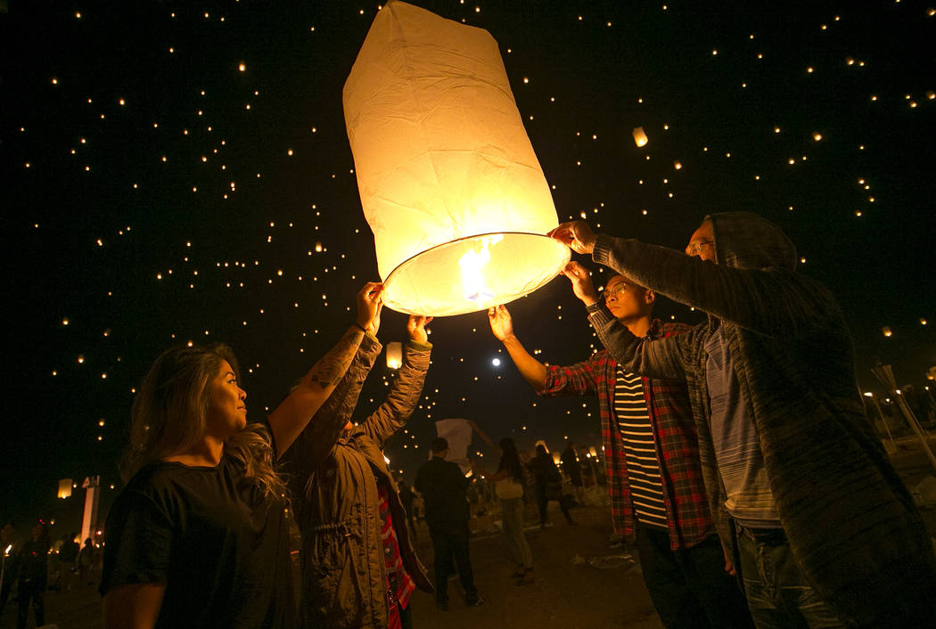 Participants prepare to release a lanterns during the RiSE Lantern Festival held at the Moapa River Indian Reservation on Friday, Oct. 6, 2017. Richard Brian Las Vegas Review-Journal @vegasphotograph