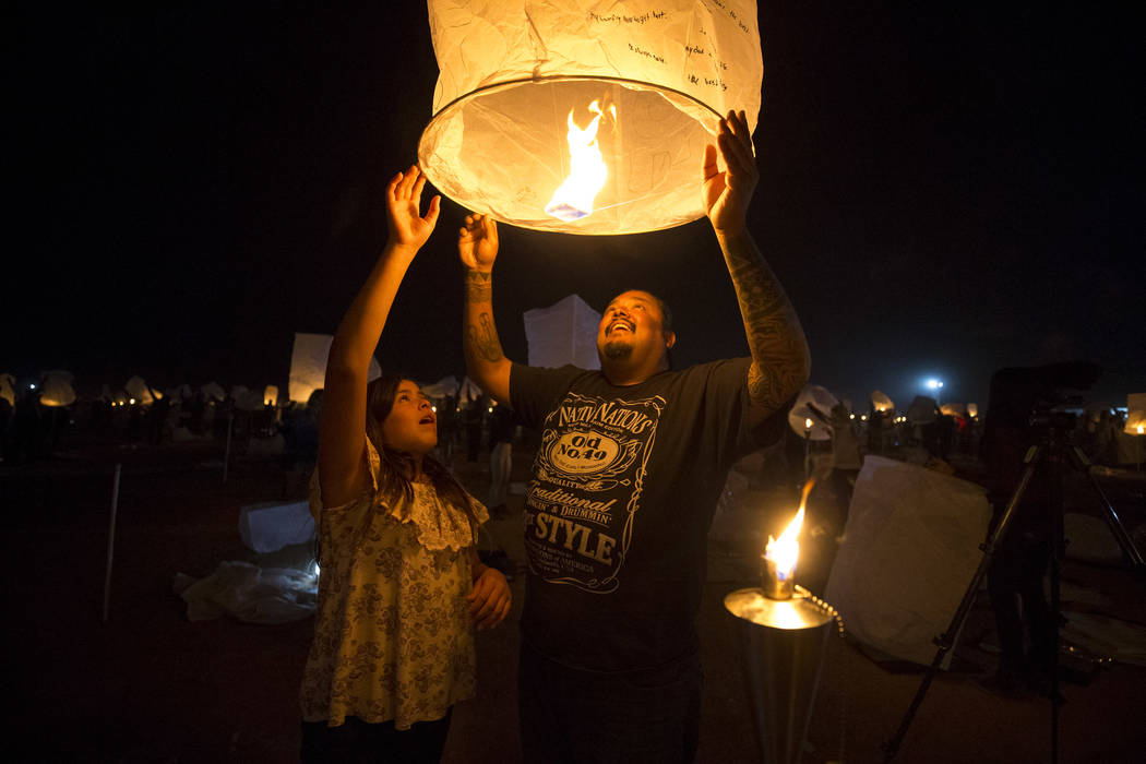 Harold Arres and his daughter Hattie release a lantern during the RiSE Lantern Festival held at the Moapa River Indian Reservation on Friday, Oct. 6, 2017. Richard Brian Las Vegas Review-Journal @ ...