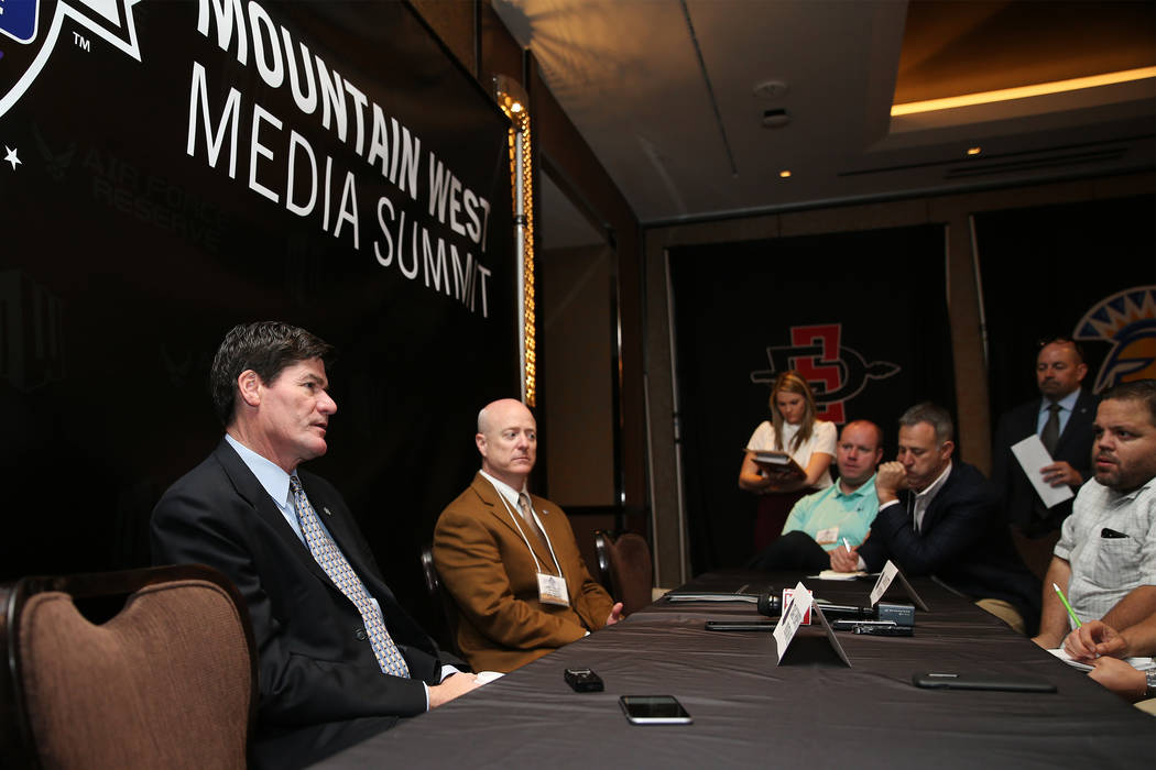 Commissioner Craig Thompson, left, with Senior Associate Commissioner Dan Butterfly, speaks during the Mountain West Conference Media Summit at The Cosmopolitan of Las Vegas, Tuesday, Oct. 16, 201 ...