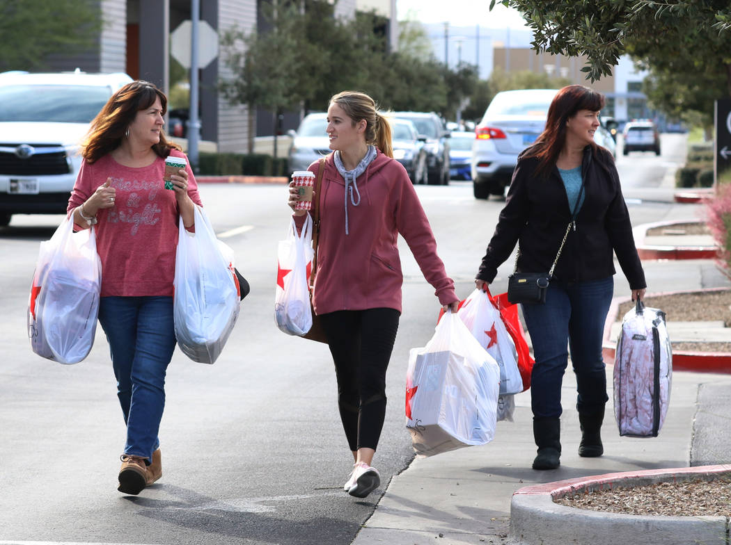 Gina Jackson, left, her daughter Haley and Angie Boschetto leave Macy's store after shopping during Black Friday in Summerlin on Friday, Nov. 23, 2018. Bizuayehu Tesfaye Las Vegas Review-Journal @ ...