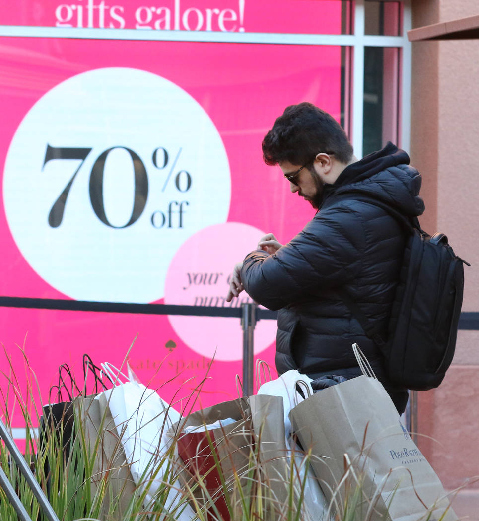 Paulo Soares of Brazil waits for his girlfriend after shopping during Black Friday at the North Premium Outlet Mall on Friday, Nov. 23, 2018. Bizuayehu Tesfaye Las Vegas Review-Journal @bizutesfaye