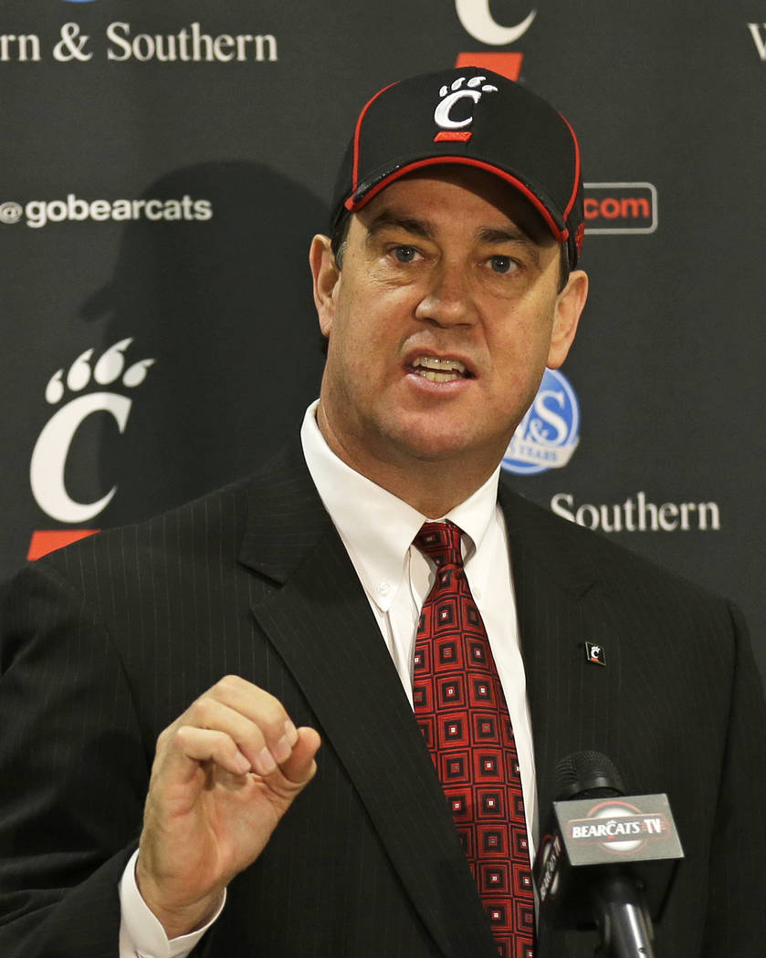 Mike Bohn speaks at a news conference after he was named the new athletic director at the University of Cincinnati, Thursday, Feb. 6, 2014, at the university in Cincinnati. Bohn had been athletic ...