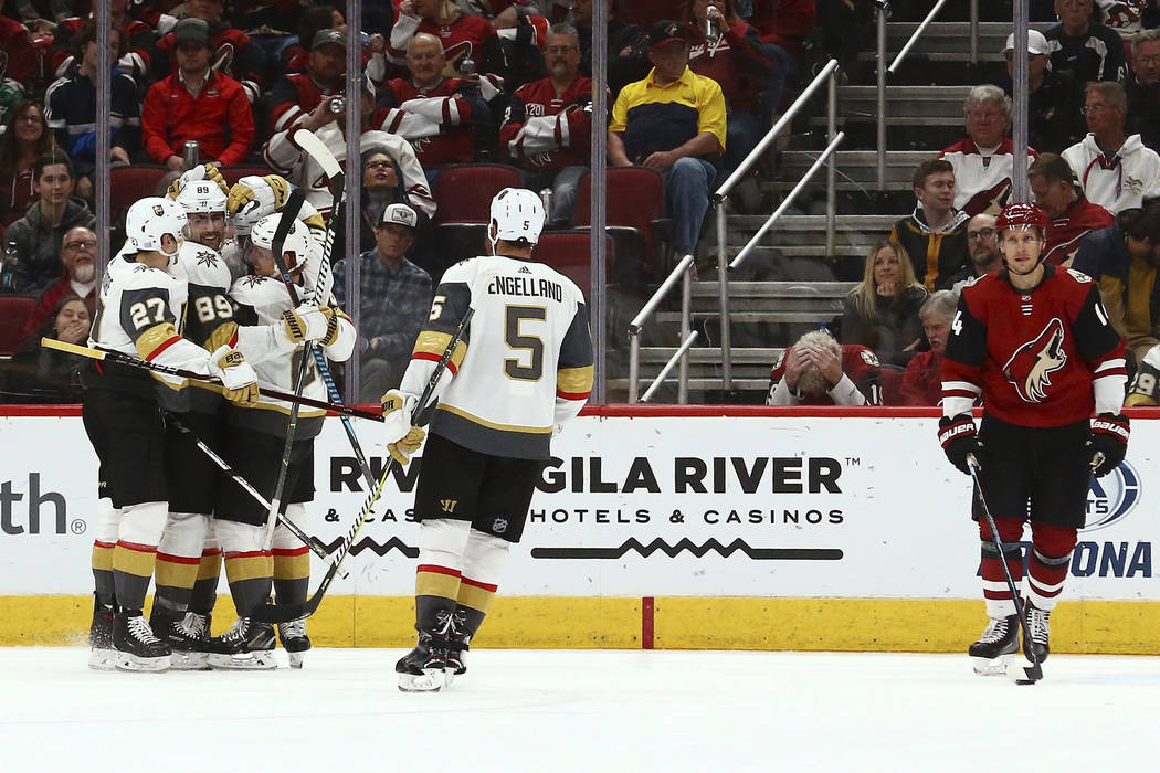 From left to right, Vegas Golden Knights defenseman Shea Theodore, right wing Alex Tuch, left wing Max Pacioretty, center Cody Eakin and defenseman Deryk Engelland celebrate Pacioretty's goal as A ...