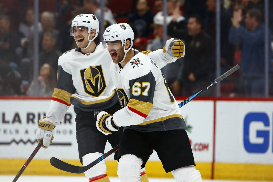 Vegas Golden Knights left wing Max Pacioretty (67) celebrates his goal against the Arizona Coyotes with Shea Theodore, left, during overtime of an NHL hockey game Wednesday, Nov. 21, 2018, in Glen ...