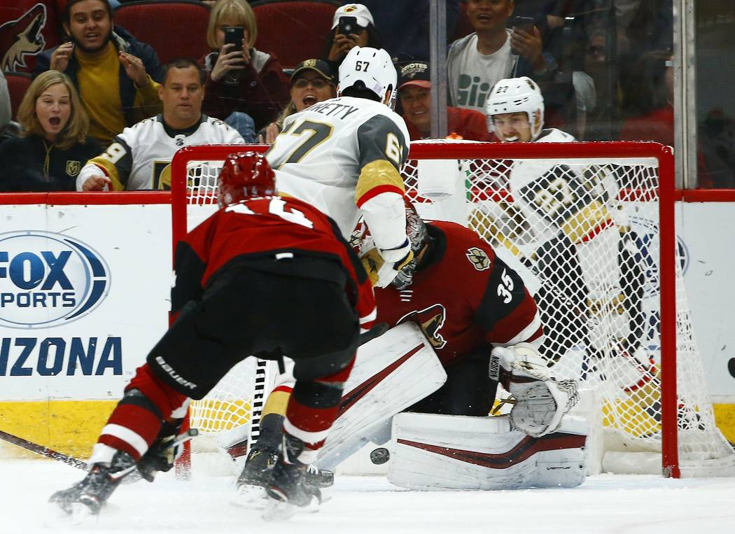 Vegas Golden Knights left wing Max Pacioretty (67) scores against Arizona Coyotes goaltender Darcy Kuemper (35) as he gets past Coyotes right wing Richard Panik (14) during overtime in an NHL hock ...