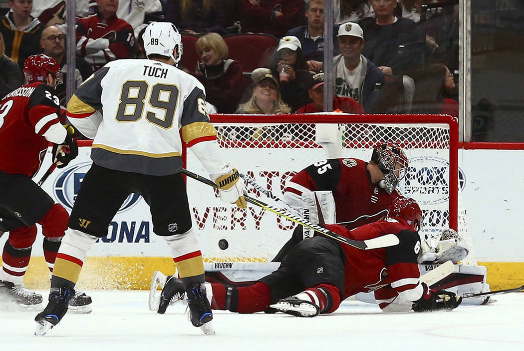 Arizona Coyotes goaltender Darcy Kuemper (35) gives up a goal to Vegas Golden Knight Max Pacioretty as Coyotes defenseman Jakob Chychrun (6), Coyotes defenseman Oliver Ekman-Larsson (23) and Golde ...