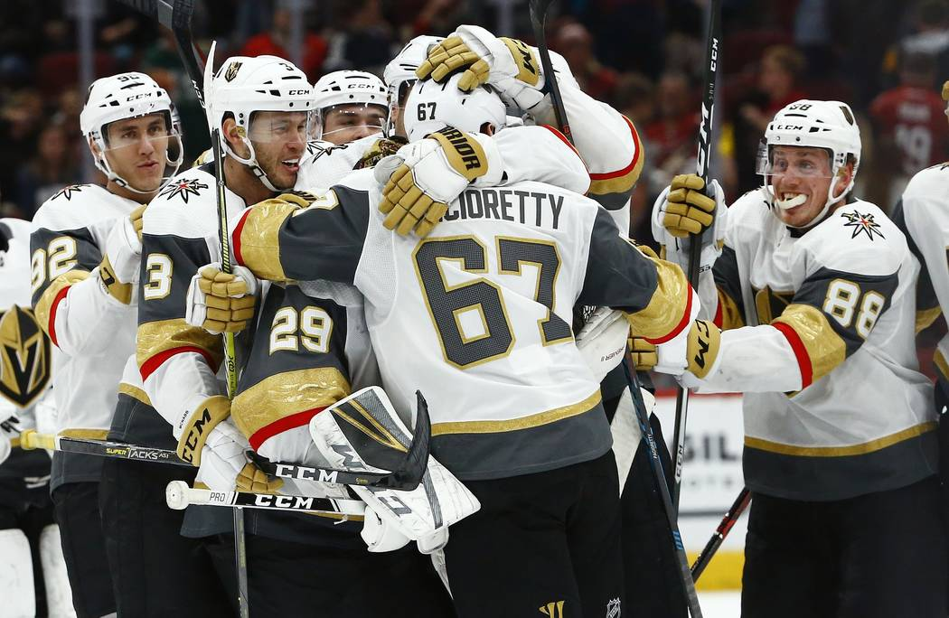 Vegas Golden Knights left wing Max Pacioretty (67) celebrates his game-winning goal against the Arizona Coyotes with left wing Tomas Nosek (92), defenseman Brayden McNabb (3), goaltender Marc-Andr ...