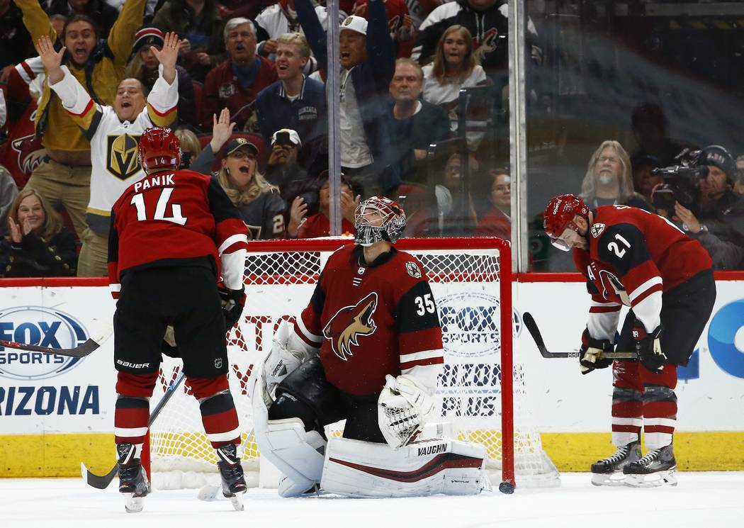 Arizona Coyotes right wing Richard Panik (14), goaltender Darcy Kuemper (35) and center Derek Stepan (21) pause on the ice after Vegas Golden Knights' Max Pacioretty scored in overtime of an NHL h ...
