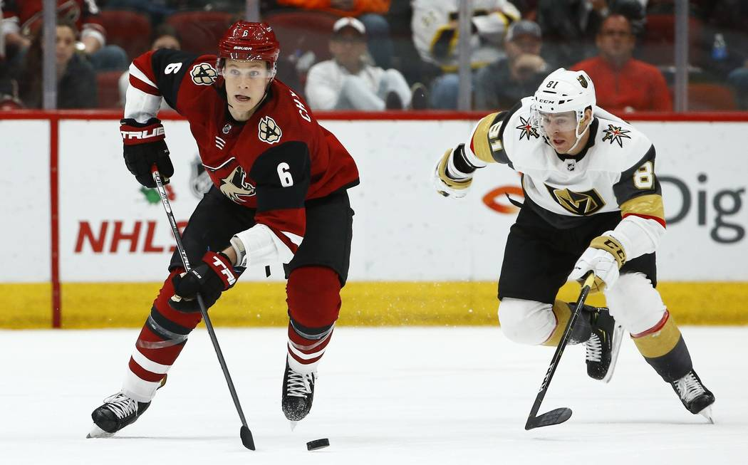 Arizona Coyotes defenseman Jakob Chychrun (6) skates with the puck in front of Vegas Golden Knights center Jonathan Marchessault (81) during overtime of an NHL hockey game Wednesday, Nov. 21, 2018 ...