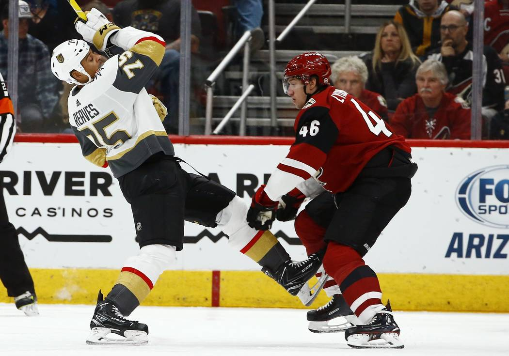 Arizona Coyotes defenseman Ilya Lyubushkin (46) checks Vegas Golden Knights right wing Ryan Reaves (75) during the second period of an NHL hockey game Wednesday, Nov. 21, 2018, in Glendale, Ariz. ...