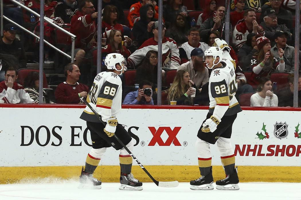 Vegas Golden Knights left wing Tomas Nosek (92) celebrates his goal against the Arizona Coyotes with defenseman Nate Schmidt (88) during the second period of an NHL hockey game Wednesday, Nov. 21, ...