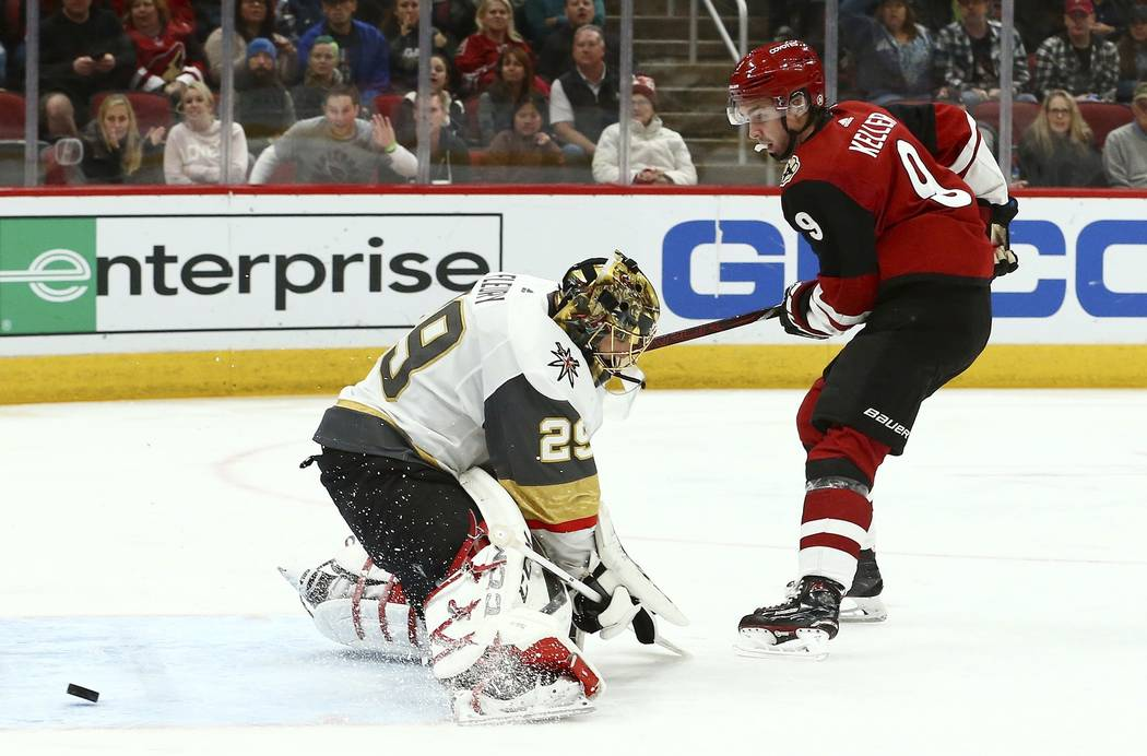 Arizona Coyotes center Clayton Keller (9) has his shot go wide of Vegas Golden Knights goaltender Marc-Andre Fleury (29) during the second period of an NHL hockey game Wednesday, Nov. 21, 2018, in ...