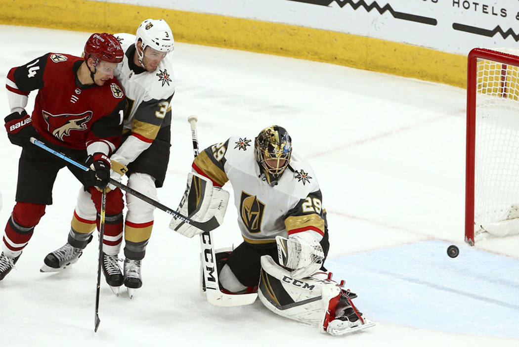 Vegas Golden Knights goaltender Marc-Andre Fleury (29) gives up a goal to Arizona Coyotes Derek Stepan as Coyotes right wing Richard Panik (14) and Golden Knights defenseman Brayden McNabb (3) loo ...