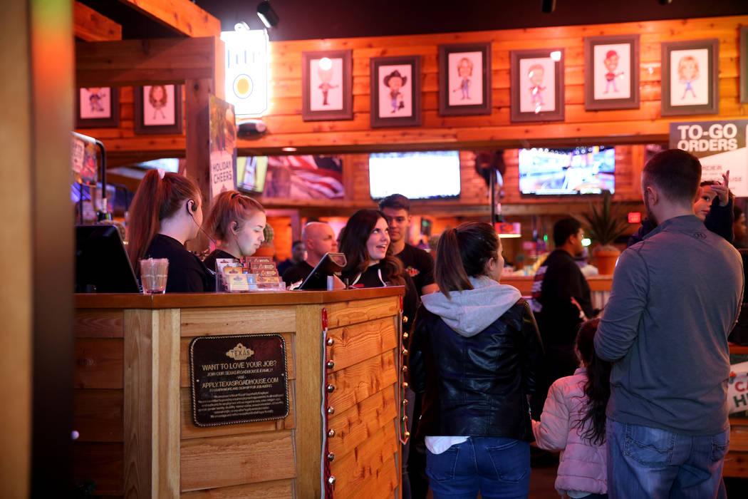Anfitriones dan la bienvenida a los invitados a Texas Roadhouse en 1380 E. Craig Road en el norte de Las Vegas el miércoles 12 de diciembre de 2018. K.M. Cannon Las Vegas Review-Journal @KMCannon ...