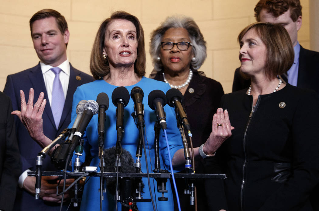 House Minority Leader Nancy Pelosi, D-Calif., joined by from left, Rep. Eric Swalwell, D-Calif., Rep. Joyce Beatty, D-Ohio., and Rep. Kathy Castor, D-Fla., speaks to media at Longworth House Offic ...
