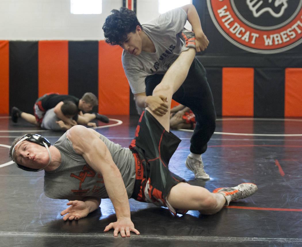 Caleb Roach, left/bottom, and Jakob Alvarado work through drills during wrestling practice on Friday, Jan. 25, 2019, at Las Vegas High School, in Las Vegas. (Benjamin Hager/Las Vegas Review-Journa ...