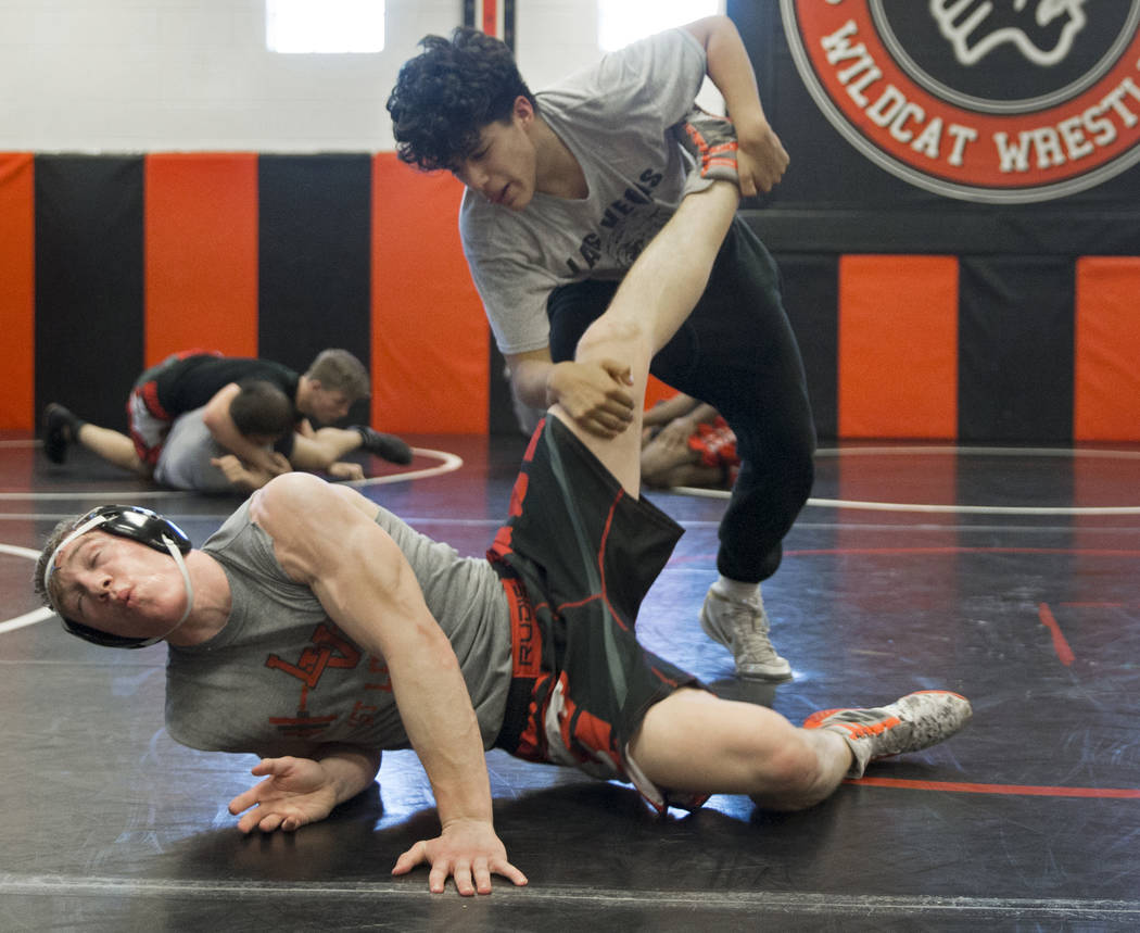 Caleb Roach, left/bottom, and Jakob Alvarado work through drills during wrestling practice on Friday, Jan. 25, 2019, at Las Vegas High School, in Las Vegas. (Benjamin Hager/Las Vegas Review-Journa ...
