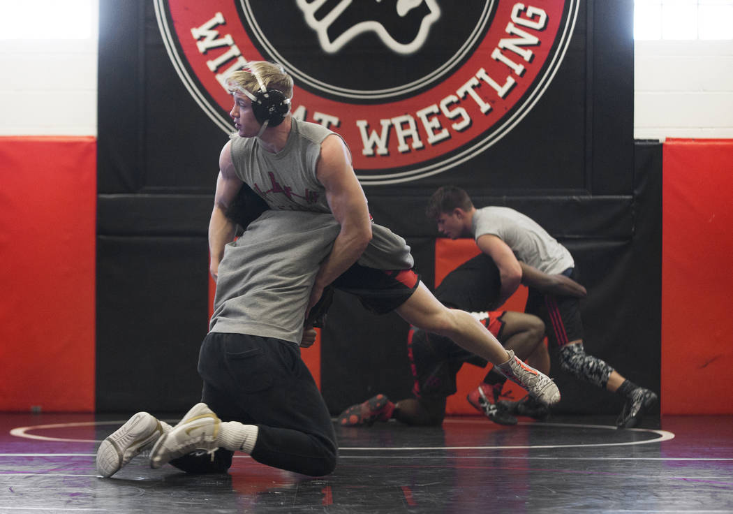 Caleb Roach, left/top, and Jakob Alvarado work through drills during wrestling practice on Friday, Jan. 25, 2019, at Las Vegas High School, in Las Vegas. (Benjamin Hager/Las Vegas Review-Journal) ...