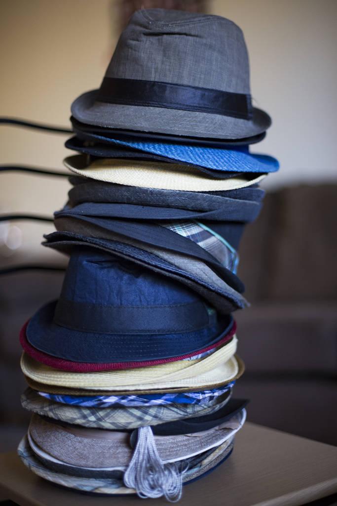 Los sombreros distintivos del comediante Brandon Cox Sanford en su casa en Henderson, el martes 19 de febrero de 2019. Cox Sanford nació con el VIH y lo menciona en sus sets de pie para remover e ...