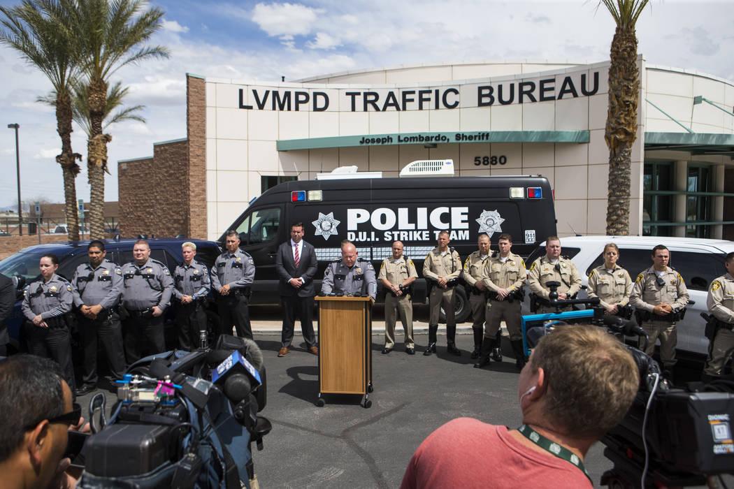 Nevada Highway Patrol Capt. Charles Haycox, center, speaks during an event marking 500 arrests ...