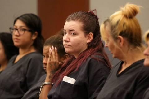 Diana Peña, centro, una de los tres sospechosos del asesinato de un médico de California, com ...