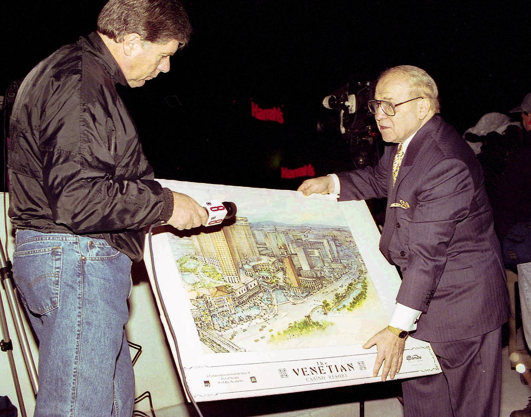 Sheldon Adelson, right, displays a rendering of the Venetian to a reporter on November 26, 1996 ...