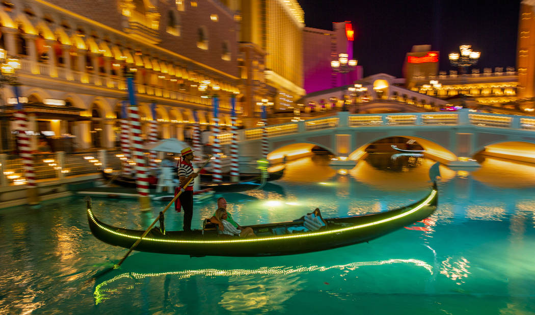 Tourists ride gondolas at The Venetian on Wednesday, April 24, 2019, in Las Vegas. (L.E. Baskow ...