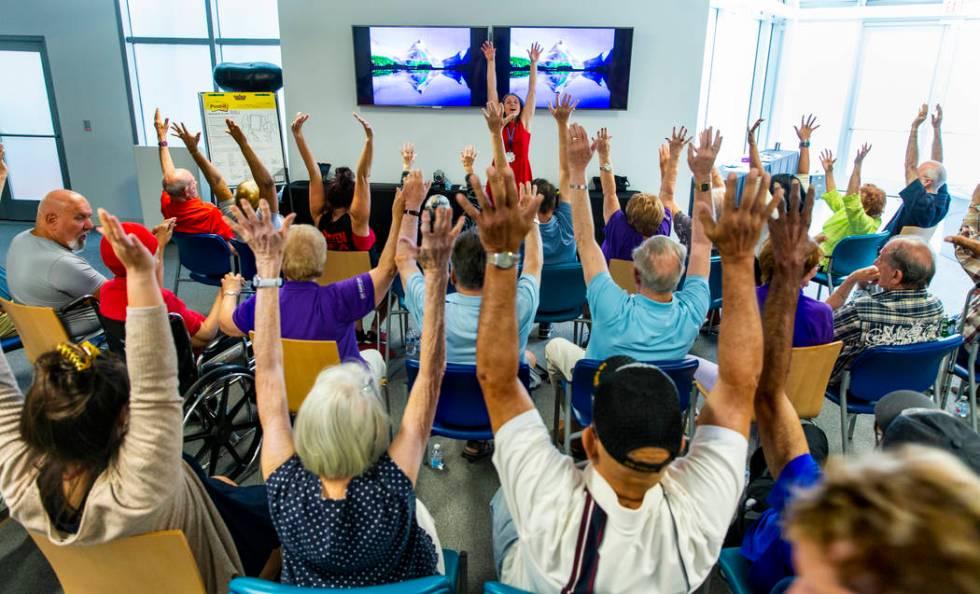 La asistente administrativa Verla Niebuhr dirige ejercicios grupales con canciones, historias y ...