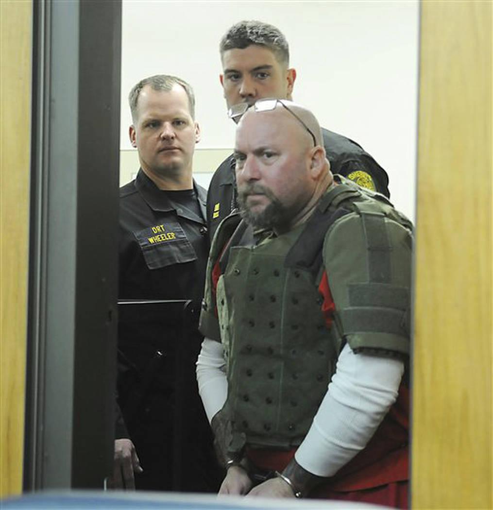 En esta foto de archivo del 9 de diciembre de 2011, el acusado del asesinato Gary Rudnick ingre ...