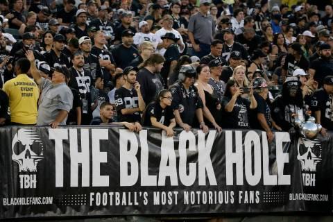 Los fans de los Raiders que componen The Black Hole disfrutan de su papel antagónico, llamánd ...